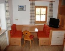 Appartements Metzmuehle - Sitzgelegenheit in der Wohnung 1