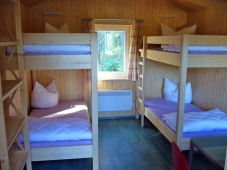 Campingplatz Harz-Camping - Blick in die Holzhuetten